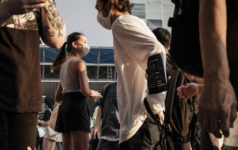 People wear face masks in Tokyo on July 28, 2021, a day after the city reported a record 2,848 new daily cases of Covid-19 coronavirus. (Photo by Yasuyoshi CHIBA / AFP)