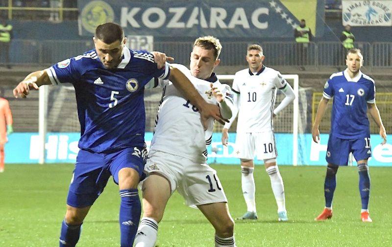 Bosnia and Herzegovina's defender Sead Kolasinac (L) vies with Northern Ireland's forward Kyle Lafferty (R) during the UEFA Euro 2020 Play-off Semi-Final football match between Bosnia and Herzegovina and Northern Ireland in Sarajevo on October 8, 2020. (Photo by ELVIS BARUKCIC / AFP)