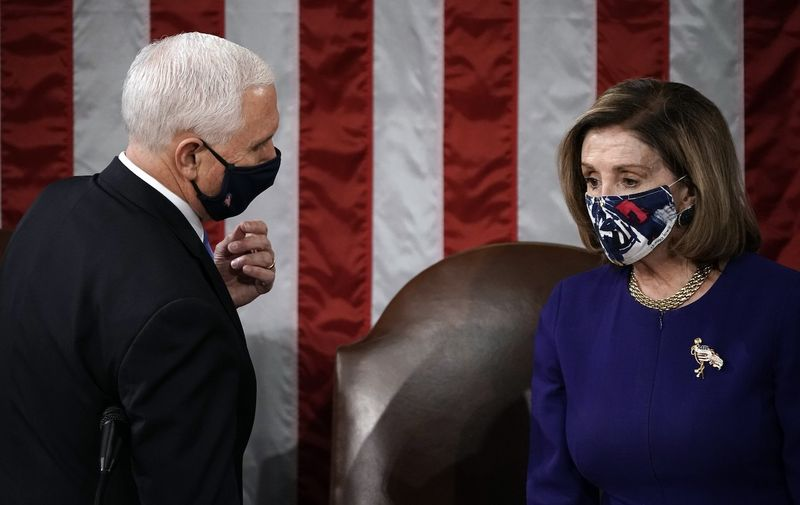 Speaker of the United States House of Representatives Nancy Pelosi (Democrat of California), and US Vice President Mike Pence talk before a joint session of the House and Senate convenes to confirm the Electoral College votes cast in November's election, at the Capitol in Washington,. US House Electoral Vote Count, Washington, District of Columbia, USA - 06 Jan 2021,Image: 581513469, License: Rights-managed, Restrictions: , Model Release: no