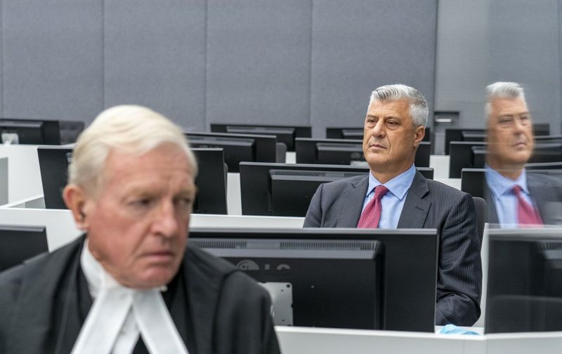 Kosovar former president Hashim Thaci sits with his lawyer David Hooper (L)  for the first time before a war crimes court in The Hague on November 9, 2020, to face charges relating to the 1990s conflict with Serbia. - The one-time guerrilla leader, 52, who resigned as president last week, wore a grey suit and red tie for the hearing at the Kosovo Specialist Chambers in the Dutch city. (Photo by Jerry Lampen / various sources / AFP) / Netherlands OUT