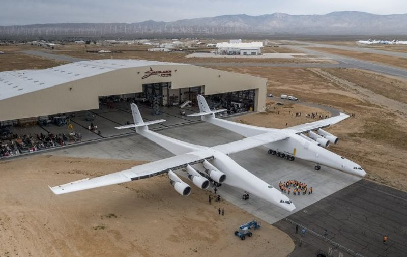 "The Stratolaunch plane is pushed out of the hanger for the first time in the Mojave desert, California on May 31, 2017. A colossal rocket-launching plane touted as the future of space travel is closer to testing, having been rolled out of a hangar in the desert, its creators said. The project backed by billionaire Microsoft co-founder Paul Allen has been proceeding for about six years and was on track for its first launch demonstration as early at 2019, Stratolaunch Systems Corporation chief executive Jean Floyd said in a blog post.  / AFP PHOTO / Stratolaunch Systems Corp / April Keller / RESTRICTED TO EDITORIAL USE - MANDATORY CREDIT ""AFP PHOTO / Stratolaunch Systems Corp/ April Keller"" - NO MARKETING NO ADVERTISING CAMPAIGNS - DISTRIBUTED AS A SERVICE TO CLIENTS"