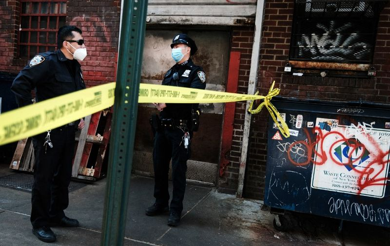 NEW YORK, NEW YORK - MARCH 30: Police gather at the scene of an afternoon shooting along Ludlow Street in a trendy section of lower Manhattan on March 30, 2021 in New York City. A man was shot and seriously injured in the shooting just steps away from upscale boutiques and hotels. New York City has seen a 40-percent rise in shootings over the same period of the previous year.   Spencer Platt/Getty Images/AFP (Photo by SPENCER PLATT / GETTY IMAGES NORTH AMERICA / Getty Images via AFP)