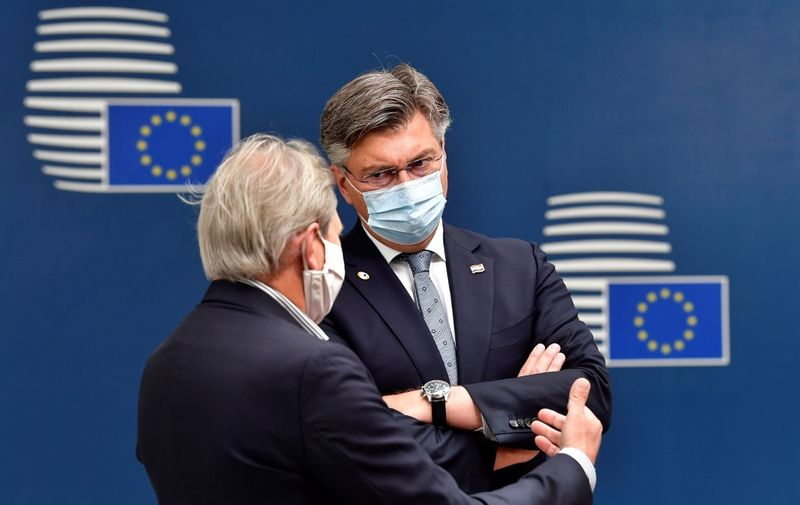 Croatia's Prime Minister Andrej Plenkovic (C) arrives for an EU summit at the European Council building in Brussels, on July 19, 2020, as the leaders of the European Union hold their first face-to-face summit over a post-virus economic rescue plan. - The EU has been plunged into a historic economic crunch by the coronavirus crisis, and EU officials have drawn up plans for a huge stimulus package to lead their countries out of lockdown. (Photo by JOHN THYS / POOL / AFP)