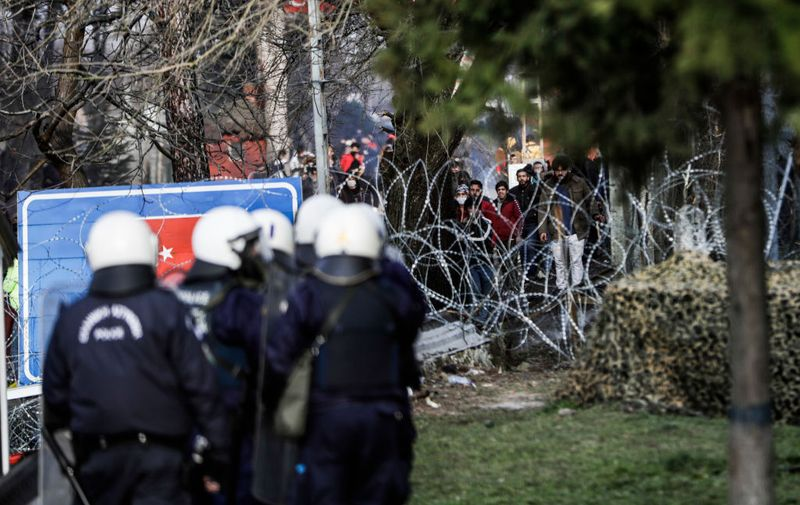 KASTANIES, GREECE - MARCH 01: Greek riot police and the army hold positions as migrants toss rocks and other projectiles on the Greek-Turkish border gate on March 1, 2020 in Kastanies, Greece. Turkey said it would no longer stop refugees from reaching Europe days after the country suffered heavy losses during an attack in Syria. (Photo by Byron Smith/Getty Images)