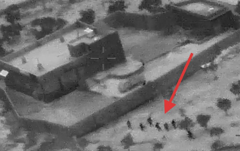 """This still image from video released by the US Department of Defense on October 30, 2019, shows US forces (lower R) advancing on the compound of ISIS leader Abu Bakr al-Baghdadi in Syria on October 26, 2019. (Photo by Jose ROMERO / US Department of Defense / AFP) / RESTRICTED TO EDITORIAL USE - MANDATORY CREDIT """"AFP PHOTO / US Department of Defense"""" - NO MARKETING - NO ADVERTISING CAMPAIGNS - DISTRIBUTED AS A SERVICE TO CLIENTS"""
