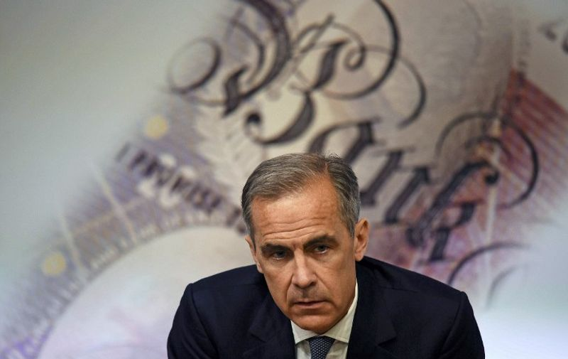 """Governor of the Bank of England Mark Carney, speaks during the Bank of England Financial Stability Report press conference, at the central bank in central London on July 5, 2016. The Bank of England on Tuesday relaxed commercial banks' capital requirements to boost lending to businesses and households, and warned that financial stability risks """"have begun to crystallise"""" after Brexit. BoE governor Mark Carney pledged it would do whatever is needed to aid monetary and fiscal stability in the wake of the June 23 referendum that saw Britain vote to exit the EU. / AFP PHOTO / POOL / DYLAN MARTINEZ"""