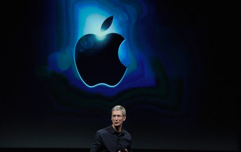 """(FILES): This October 4, 2011 photograph shows Apple CEO Tim Cook during an event introducing the new iPhone 4s at the company's headquarters in Cupertino, California.  The death on Wednesday, October 5, 2011 of Apple founder Steve Jobs will likely raise new concerns about whether the California-based company can survive without his vision and flair for invention. The spotlight will be on freshly-anointed Apple chief Tim Cook who immediately paid tribute to the 56-year-old Jobs calling him an """"inspiring mentor.""""      Kevork Djansezian/Getty Images/AFP / AFP PHOTO / GETTY IMAGES NORTH AMERICA / KEVORK DJANSEZIAN"""