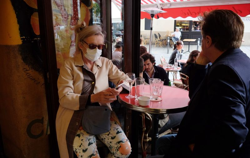 New normality in the cafes and restaurants of Paris, France, after the speech of President Macron for the deconfinement for covid 19 Coronavirus outbreak reopening, Paris, France - 15 Jun 2020,Image: 531971748, License: Rights-managed, Restrictions: , Model Release: no