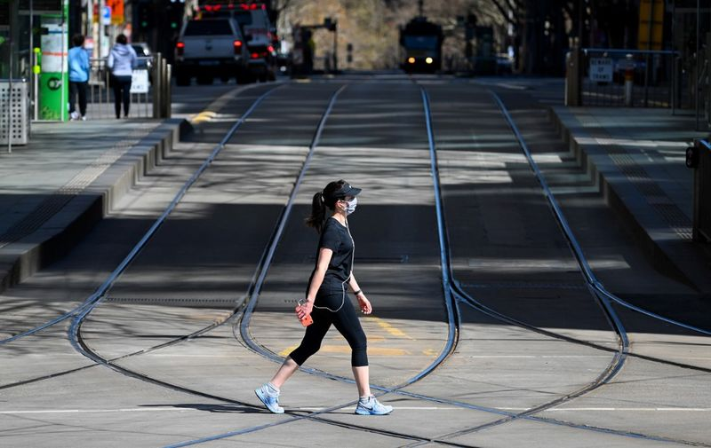 A woman takes a walk in Melbourne on September 6, 2020 as the state announced an extension to its strict lockdown law while it battles fresh outbreaks of the COVID-19 coronavirus. (Photo by William WEST / AFP)