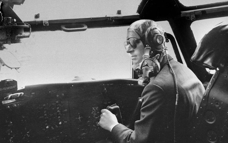 FILE - In this April 11, 1956 file photo the Duke of Edinburgh controls a Blackburn military transport plane a few minutes before a fire extinguisher burst and filled the cockpit with choking fumes. Buckingham Palace says Prince Philip, husband of Queen Elizabeth II, has died aged 99. (AP Photo/File)