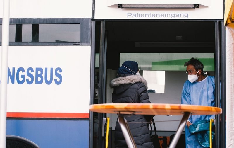 General view of  a woman waits for her vaccination during the opening of vaccinebus piolot project in Chorweiler of Cologne, Germany on May 3, 2021 Vaccination Bus Pilot Projet Starts In High Infection District In Cologne, Germany - 03 May 2021,Image: 609135261, License: Rights-managed, Restrictions: , Model Release: no, Credit line: Profimedia
