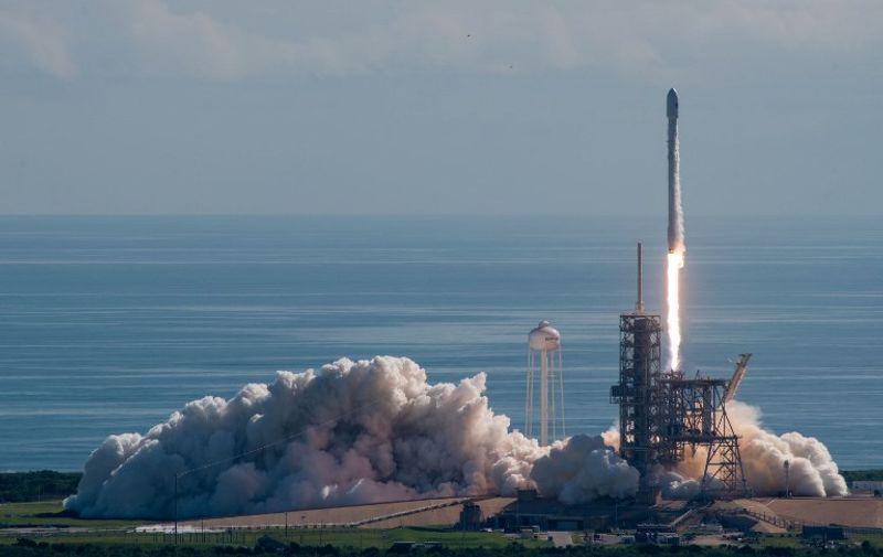 """This image obtained from SpaceX shows a Falcon 9 rocket carrying the unmanned X-37B drone lifting off at 10:00 am (1400 GMT) from NASA's Kennedy Space Center on September 7, 2017. This was SpaceX's second mission for the Pentagon this year following a secret satellite launch in May and the private company's first launch of the X-37B, a secret US Air Force space plane. / AFP PHOTO / SPACEX / HO / RESTRICTED TO EDITORIAL USE - MANDATORY CREDIT """"AFP PHOTO / SPACEX"""" - NO MARKETING NO ADVERTISING CAMPAIGNS - DISTRIBUTED AS A SERVICE TO CLIENTS"""