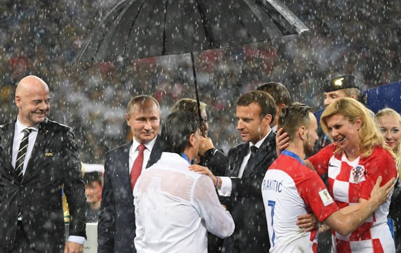 5592915 15.07.2018 From left, FIFA President Gianni Infantino, Russia's President Vladimir Putin, France's President Emmanuel Macron and Croatia's President Kolinda Grabar-Kitarovic attend the awarding ceremony after the World Cup final soccer match between France and Croatia at the Luzhniki stadium, in Moscow, Russia, July 15, 2018. Grigoriy Sisoev / Sputnik
