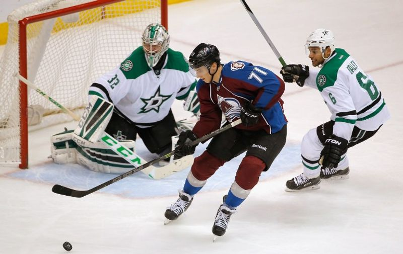 DENVER, CO - JANUARY 10: Borna Rendulic #71 of the Colorado Avalanche controls the puck against Trevor Daley #6 and goalie Kari Lehtonen #32 of the Dallas Stars at Pepsi Center on January 10, 2015 in Denver, Colorado. The Avalanche defeated the Stars 4-3.   Doug Pensinger/Getty Images/AFP