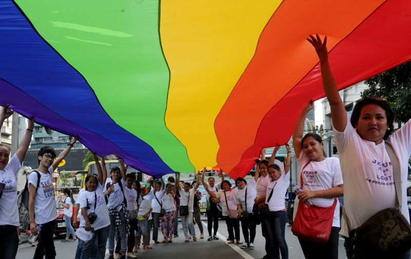 Filipino members and supporters of the LGBT community take part in an annual gay pride march calling for equal rights for lesbian, gay, bisexual and transgender (LGBT) people in suburban Manila on December 5, 2015. The Philippines made headlines when it held the first gay pride march in Asia in 1994 and a few years ago became the first country in Southeast Asia to have an official gay political party.  AFP PHOTO / Jay DIRECTO / AFP / JAY DIRECTO