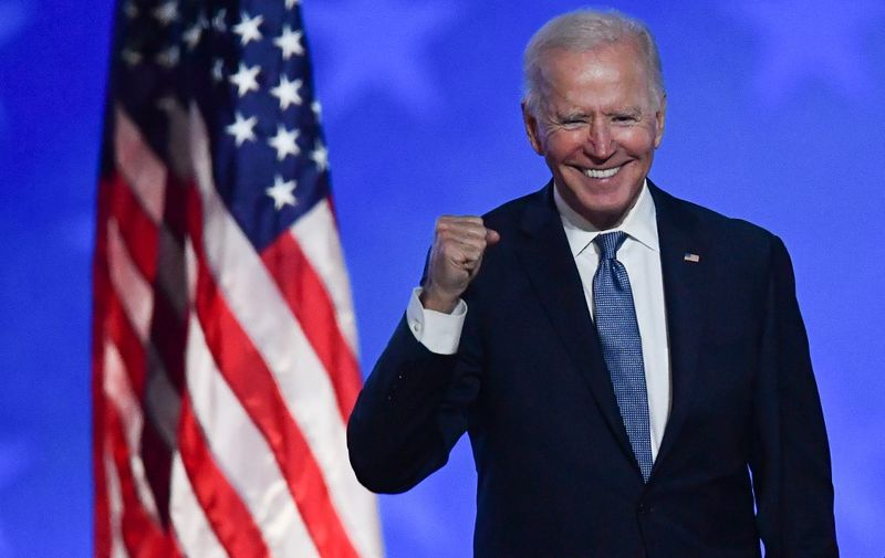 """Democratic presidential nominee Joe Biden gestures after speaking during election night at the Chase Center in Wilmington, Delaware, early on November 4, 2020. - Democrat Joe Biden said early Wednesday he believes he is """"on track"""" to defeating US President Donald Trump, and called for Americans to have patience with vote-counting as several swing states remain up in the air. """"We believe we are on track to win this election,"""" Biden told supporters in nationally broadcast remarks delivered in his home city of Wilmington, Delaware, adding: """"It ain't over until every vote is counted."""" (Photo by ANGELA  WEISS / AFP)"""