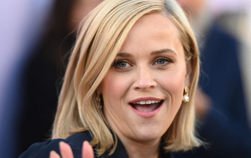 """(FILES) In this file photo taken on December 11, 2019 Actor Reese Witherspoon attends the Hollywood Reporter's annual Women in Entertainment Breakfast Gala, at Milk Studios in Hollywood, California. - Reese Witherspoon's women-focused production company behind television hits such as """"Big Little Lies"""" is being purchased by a new private equity-backed venture aiming to break into Hollywood's fast-expanding streaming market. (Photo by Robyn Beck / AFP)"""