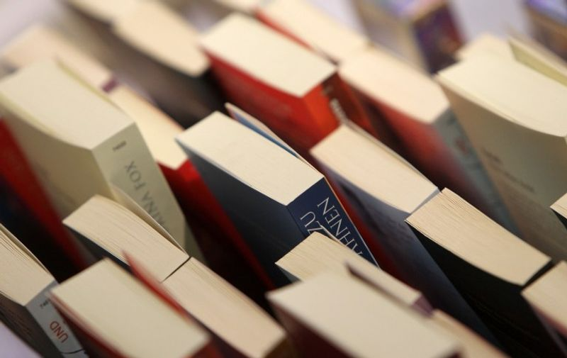 Books are on display at the Book Fair in Frankfurt am Main, western Germany on October 14, 2015. AFP PHOTO / DANIEL ROLAND