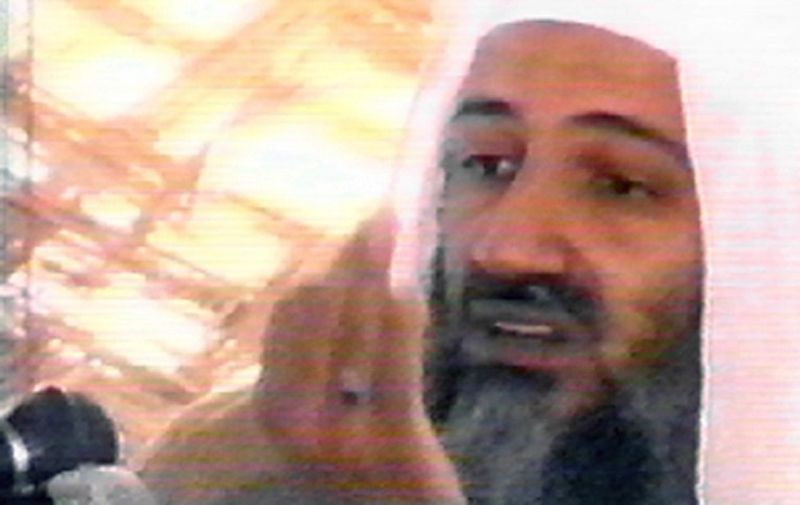 This undated video grab shows Saudi-born alleged terrorism mastermind Osama bin Laden speaking at an undisclosed location in Afghanistan from a video said to have been prepared by bin Laden himself. Copies of the tape, which shows him as well as al-Qaeda guerrilla fighters training at al-Faruq camp in Afghanistan, have been circulated to a limited number of Islamists. Bin Laden is America's prime suspect behind the September 11 terrorist attacks.     AFP PHOTO/HO