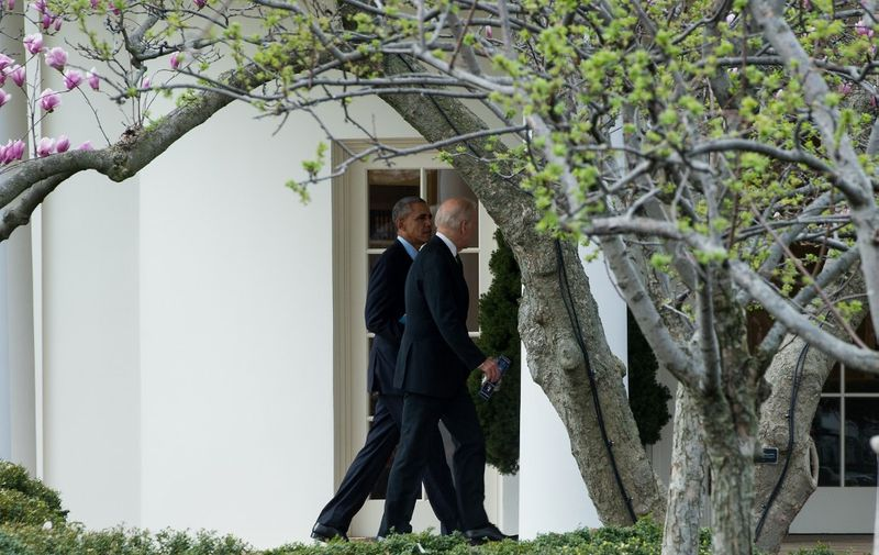 US President Barack Obama and Vice President Joe Biden walk to the Oval Office at the White House  after attending the annual Friends of Ireland Luncheon at the US Capitol in Washington, DC, on March 15, 2016. (Photo by Nicholas Kamm / AFP)