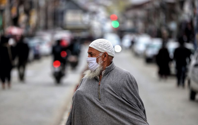 An elderly man wearing a mask walks in a market amid COVID-19 Coronavirus pandemic in Baramulla, jammu and Kashmir, India on 15 April 2021. Daily Life In Jammu And Kashmir, Baramulla, India - 15 Apr 2021,Image: 605760439, License: Rights-managed, Restrictions: , Model Release: no, Credit line: Profimedia