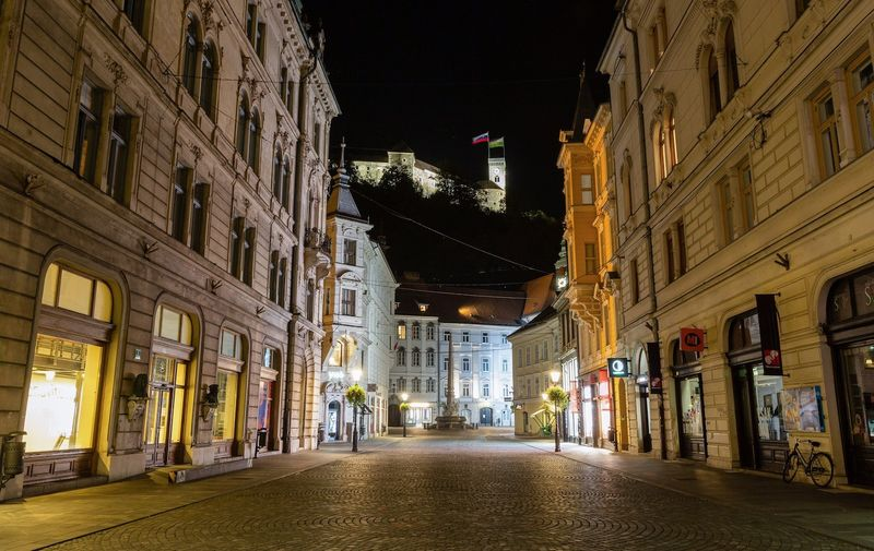 A view of an empty old city center during an overnight curfew. After re declaring an epidemic Slovenia imposed a nationwide overnight curfew to fight its surge of coronavirus infections. Itís the first time a curfew was declared in Slovenia since the start of the outbreak. The curfew is in place from 21:00 to 6:00. Overnight curfew in Ljubljana, Slovenia - 20 Oct 2020,Image: 564761889, License: Rights-managed, Restrictions: , Model Release: no