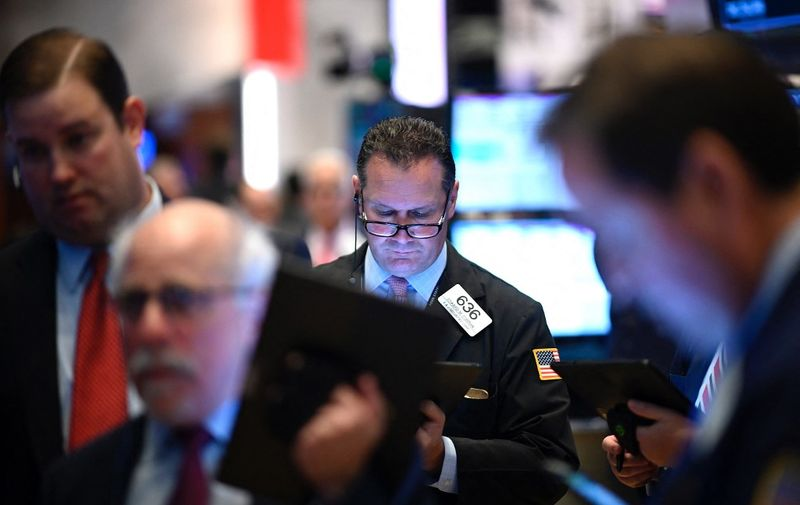 """Traders work during the opening bell at the New York Stock Exchange (NYSE) on November 4, 2019 at Wall Street in New York City. - Wall Street stocks added to records early Monday, boosted by optimism over US-China trade talks, while McDonald's retreated on an executive shakeup. Analysts cited remarks from US Commerce Secretary Wilbur Ross that """"phase one"""" of the trade agreement between Beijing and Washington was on track.""""The news seems to be getting good,"""" J.J. Kinahan, chief market strategist at TD Ameritrade, said of the trade developments. (Photo by Johannes EISELE / AFP)"""