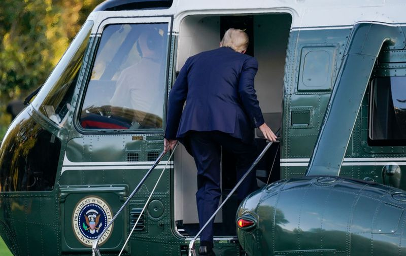 WASHINGTON, DC - OCTOBER 02: U.S. President Donald Trump leaves the White House for Walter Reed National Military Medical Center on the South Lawn of the White House on October 2, 2020 in Washington, DC. President Donald Trump and First Lady Melania Trump have both tested positive for coronavirus. (Photo by Drew Angerer/Getty Images)