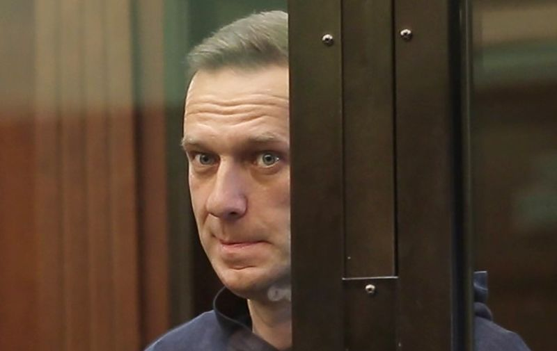 MOSCOW, RUSSIA — FEBRUARY 2, 2021: Opposition activist Alexei Navalny appears at Moscow City Court for a Simonovsky District Court hearing into an application by the Russian Federal Penitentiary Service to convert his suspended sentence of three and a half years into a real jail term. Navalny, who had been wanted in Russia since December 2020 for violating probation conditions in the Yves Rocher case, was detained at Sheremetyevo Airport near Moscow on his return to Russia from Germany on 17 January 2021. On 18 January, Moscow Region's Khimki Court ruled that Navalny be put into custody until 15 February 2021. Moscow City Court Press Service/TASS THIS IMAGE WAS PROVIDED BY A THIRD PARTY. EDITORIAL USE ONLY,Image: 588096071, License: Rights-managed, Restrictions: , Model Release: no