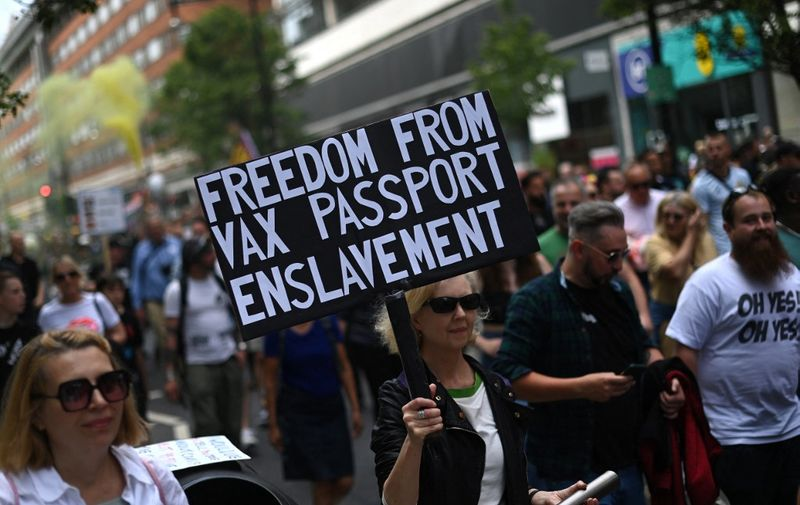 Anti-Vaccine and anti-lockdown protestors march through central London, on June 26, 2021. (Photo by DANIEL LEAL-OLIVAS / AFP)