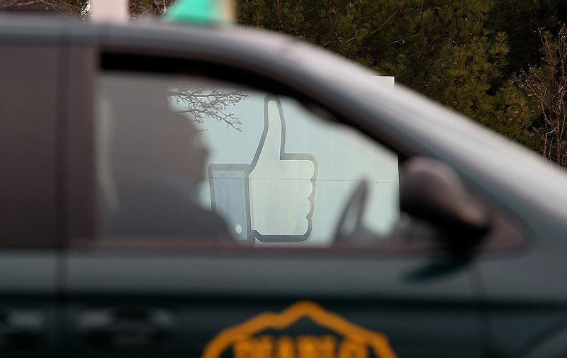 MENLO PARK, CA - FEBRUARY 01:  A taxicab passes by a sign standing in front of the Facebook headquarters on February 1, 2012 in Menlo Park, California.  Facebook is expected to file for its first initial public offering today seeking to raise at least $5 billion.  (Photo by Justin Sullivan/Getty Images)