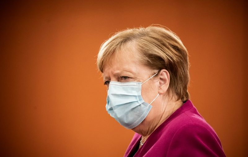German Chancellor Angela Merkel wearing a face mask frowns as she arrives to attend the weekly cabinet meeting of the German government at the Chancellery in Berlin, on October 14, 2020. (Photo by Michael Kappeler / POOL / AFP)