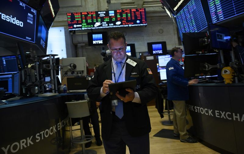 Traders work on the floor at the New York Stock Exchange (NYSE) on Wall Street in New York City on August 9, 2019. (Photo by Don Emmert / AFP)