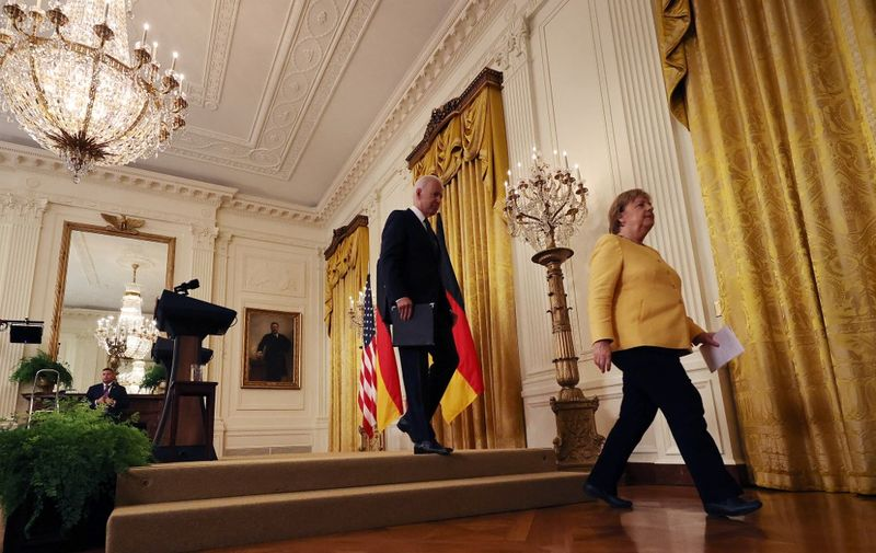 WASHINGTON, DC - JULY 15: German Chancellor Angela Merkel (R) and U.S. President Joe Biden leave a joint news conference in the East Room of the White House on July 15, 2021 in Washington, DC. During what is likely her last official visit to Washington, Merkel and Biden are expected to discuss their shared priorities on climate change and defense; and Biden voiced his concerns about the Nord Stream 2 Russian natural gas pipeline.   Chip Somodevilla/Getty Images/AFP (Photo by CHIP SOMODEVILLA / GETTY IMAGES NORTH AMERICA / Getty Images via AFP)