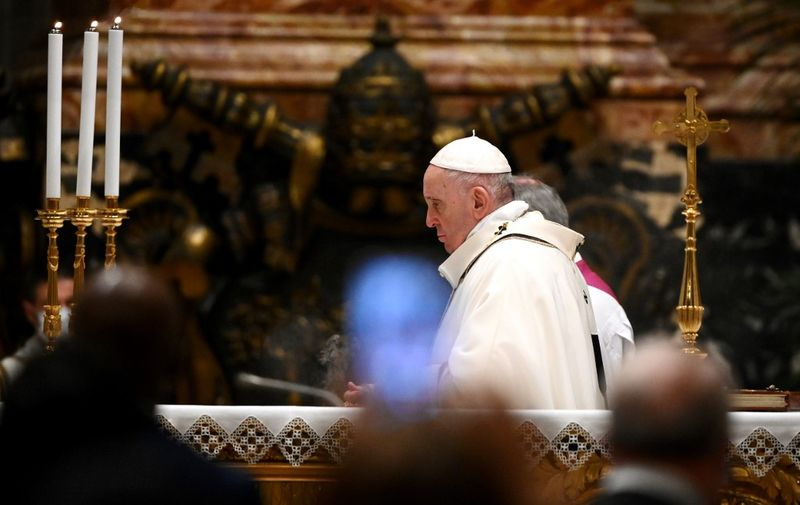 Pope Francis leads a Christmas Eve mass to mark the nativity of Jesus Christ on December 24, 2020, at St Peter's basilica in the Vatican amidst the COVID-19 pandemic caused by the novel coronavirus. (Photo by Vincenzo PINTO / various sources / AFP)