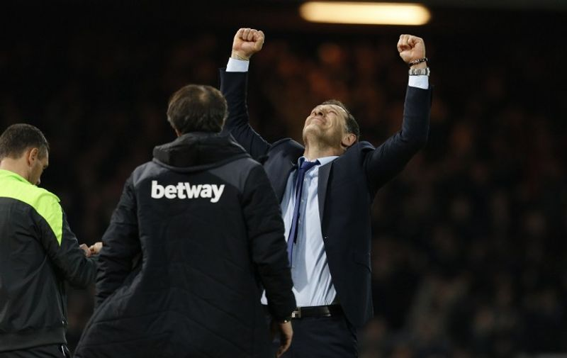 West Ham United's Croatian manager Slaven Bilic celebrates at the final whistle in the English Premier League football match between West Ham United and Southampton at The Boleyn Ground in Upton Park, in east London on December 28, 2015. West Ham won the game 2-1. AFP PHOTO / IAN KINGTON  RESTRICTED TO EDITORIAL USE. No use with unauthorized audio, video, data, fixture lists, club/league logos or 'live' services. Online in-match use limited to 75 images, no video emulation. No use in betting, games or single club/league/player publications. / AFP PHOTO / IAN KINGTON