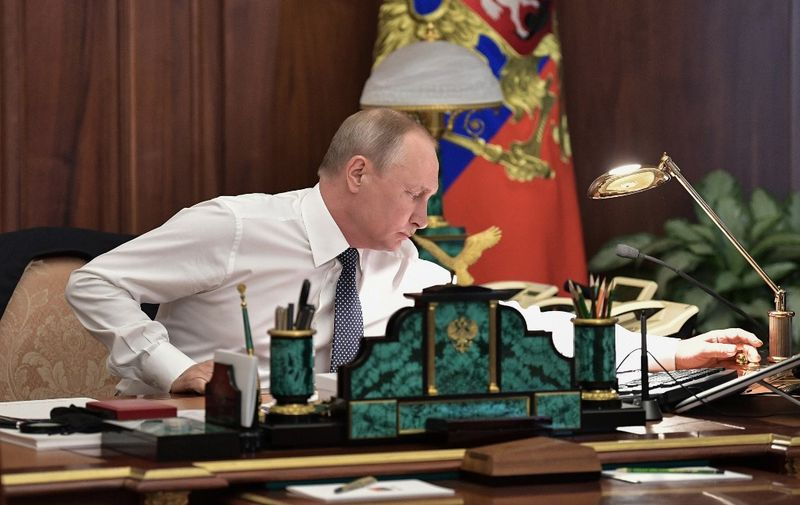 Russian president-elect Vladimir Putin at the cabinet prior to his inauguration ceremony at the Kremlin in Moscow on May 7, 2018. (Photo by Alexey NIKOLSKY / SPUTNIK / AFP)