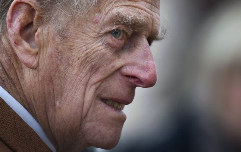 (FILES) In this file photo taken on February 05, 2012 Britain's Prince Philip, Duke of Edinburgh leaves a church service at St Peters and St Paul in West Newton, Norfolk. - Queen Elizabeth II's 99-year-old husband Prince Philip, who was recently hospitalised and underwent a successful heart procedure, died on April 9, 2021, Buckingham Palace announced. (Photo by Ben STANSALL / AFP)