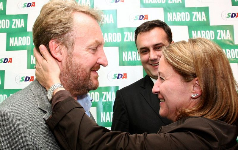 Bosnian Muslim candidate for Bosnia's tripartite Presidency, Bakir Izetbegovic (L), is congratulated by his wife Sebija Izetbegovic (R)  following the general elections, in Sarajevo, early October 4, 2010. General Bosnia's election resultsshowed moderates gaining ground in central government, but hardliners stayed firmly entrenched in the Serb entity, casting a shadow over the country's European future. Moderate Bakir Izetbegovic was set to secure the main Muslim seat in Bosnia's tripartite presidency after Sunday's vote. AFP PHOTO ELVIS BARUKCIC (Photo by ELVIS BARUKCIC / AFP)