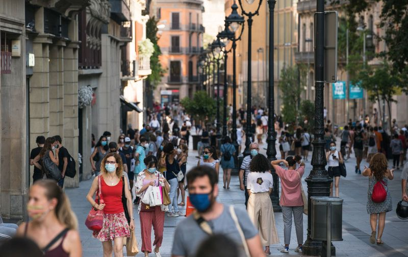 BARCELONA, SPAIN - JULY 27: People walk along Portal de l'Angel on July 27, 2020 in Barcelona, Spain. Spanish officials insisted it was still safe to travel to the country despite a recent rise in coronavirus (COVID-19) cases, which led the UK government to reimpose a 14-day quarantine on arrivals from Spain. The Catalonian government had recently issued a stay-at-home recommendation that included the regional capital, Barcelona. (Photo by Cesc Maymo/Getty Images)