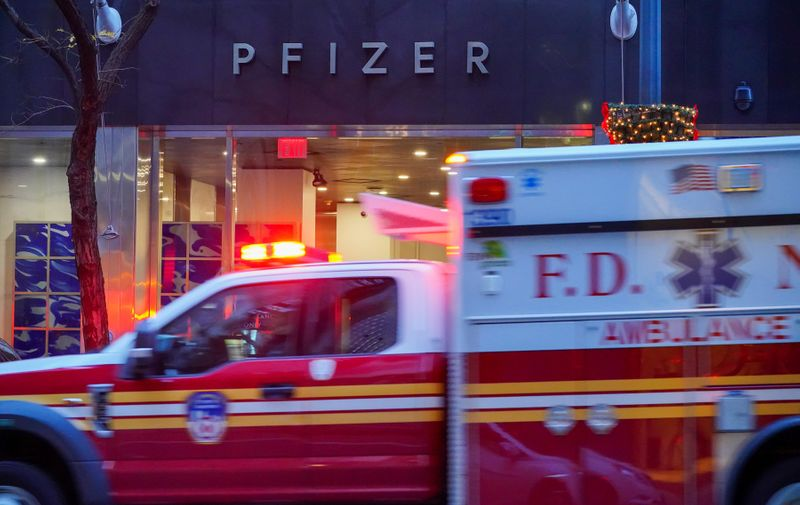 """American multinational pharmaceutical corporation, Pfizer Inc. headquarters in New York City. Pfizer stock surged higher on November 9, 2020 prior to the opening of Wall Street trading after the company announced its vaccine is """"90 percent effective"""" against Covid-19 infections. The news cheered markets worldwide, especially as coronavirus cases are spiking, forcing millions of people back into lockdown.,Image: 574393424, License: Rights-managed, Restrictions: *** World Rights ***, Model Release: no"""