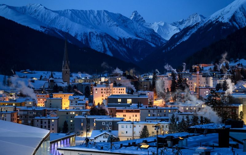 The ski resort of Davos is seen at sunrise ahead of the annual meeting of the World Economic Forum (WEF) on January 20, 2020. (Photo by Fabrice COFFRINI / AFP)