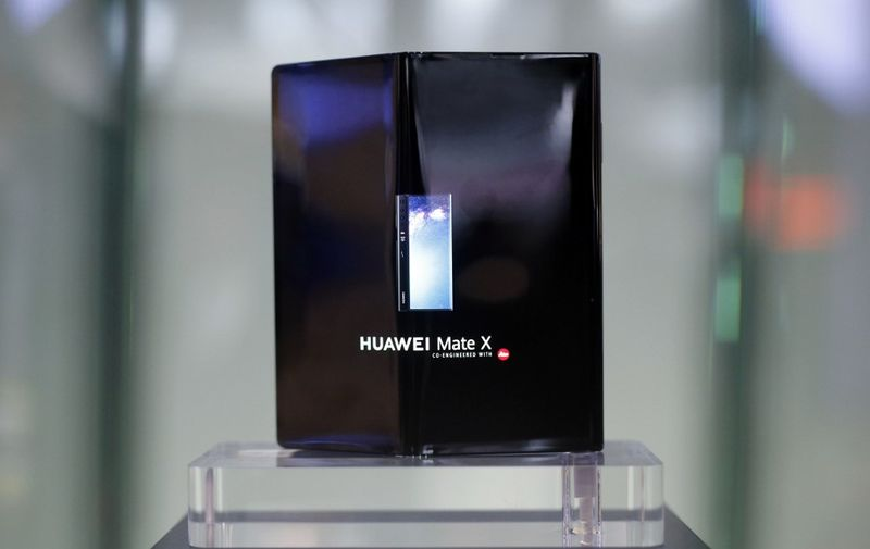 Huawei Mate X foldable smartphone is displayed at the Mobile World Congress (MWC) in Barcelona on February 28, 2019. - Phone makers will focus on foldable screens and the introduction of blazing fast 5G wireless networks at the world's biggest mobile fair as they try to reverse a decline in sales of smartphones. (Photo by Pau Barrena / AFP)