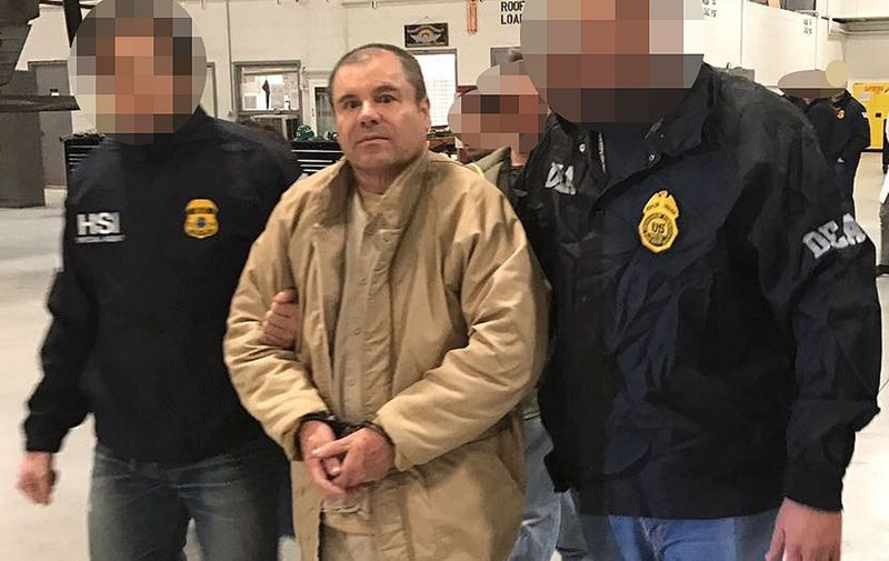 """(FILES) In this file photo taken on January 19, 2017 This handout picture released by the Mexican Interior Ministry on January 19, 2017 shows Joaquin Guzman Loera aka """"El Chapo"""" Guzman (C) escorted in Ciudad Juarez by the Mexican police as he is extradited to the United States. - After a dramatic decades-long run as one of the world's most notorious druglords, there is little suspense about what will happen in a New York courtroom on Wednesday: Joaquin """"El Chapo"""" Guzman is expected to be sentenced to life in prison. (Photo by HO / INTERIOR MINISTRY OF MEXICO / AFP) / RESTRICTED TO EDITORIAL USE-MANDATORY CREDIT """"AFP PHOTO/INTERIOR MINISTRY OF MEXICO"""" NO MARKETING NO ADVERTISING CAMPAIGNS-DISTRIBUTED AS A SERVICE TO CLIENTS-XGTY / TO GO WITH AFP STORY BY Laura BONILLA CAL: """"El Chapo expected to get life sentence from US judge""""      Pixelation of faces was done by the US Department of Justice"""