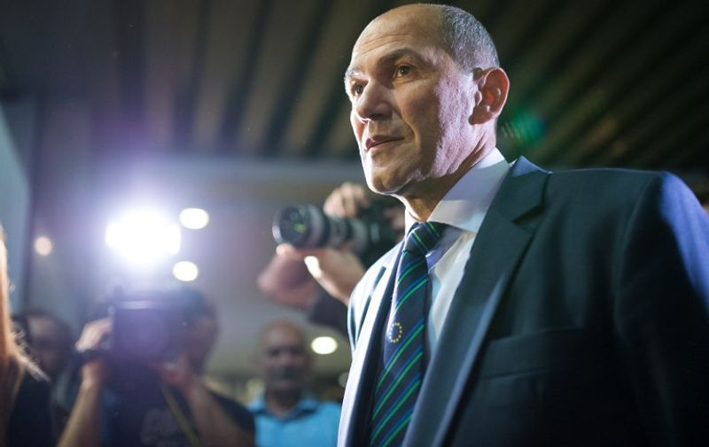 Former Slovenian Prime Minister Janez Jansa and Social Democrats Party leader arrives for a press conference after the announcement of the European Parliament elections results May 25, 2014 at the Media Centre in Ljubljana, Slovenia.  AFP PHOTO / Jure Makovec / AFP / Jure Makovec