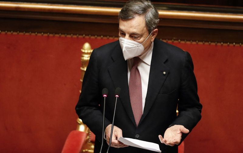 Italy's Prime Minister Mario Draghi delivers a speech during a debate at the Senate on February 17, 2021 in Rome, before submitting his government to a vote of confidence. (Photo by YARA NARDI / POOL / AFP)