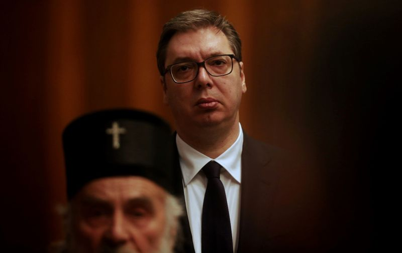 Serbian President Aleksandar Vucic (in the background) listens as Serbian Patriarch Irinej speaks, during a press conference in Belgrade on March 15, 2020.  Serbia's president declared a state of emergency on March 15n 2020 to halt the spread of the new coronavirus, shutting down many public spaces and deploying soldiers to guard hospitals.,Image: 506680922, License: Rights-managed, Restrictions: , Model Release: no
