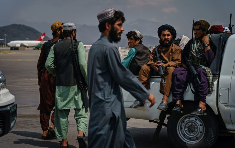 August 31, 2021 - Kabul, Afghanistan: Taliban fighters patrol the tarmac after the United States Military have completely withdrawn from the country and Taliban fighters moved in to take control of Hamid Karzai International Airport, in Kabul.,Image: 629685365, License: Rights-managed, Restrictions: No publication in Los Angeles Daily News, Orange County Register, LA Opinion, Model Release: no, Credit line: Profimedia