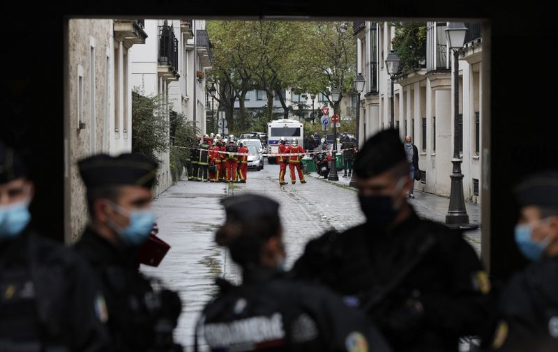 French Gendarme block the road leading to the scene of a knife attack in which several people were injured near the former offices of the French satirical magazine Charlie Hebdo in the capital Paris on September 25, 2020. - A man armed with a knife seriously wounded two people on September 25, 2020, in a suspected terror attack outside the former offices of French satirical weekly Charlie Hebdo in Paris, three weeks into the trial of men accused of being accomplices in the 2015 massacre of the newspaper's staff. Charlie Hebdo had angered many Muslims around the world by publishing cartoons of the Prophet Mohammed, and in a defiant gesture ahead of the trial this month, it reprinted the caricatures on its front cover. (Photo by GEOFFROY VAN DER HASSELT / AFP)
