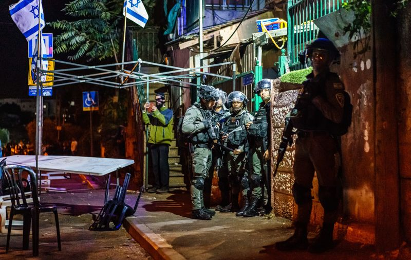 JERUSALEM, ISRAEL -- JUNE 21, 2021: Israeli police officers stand guard in front of a Jewish settler home as local residents broke into brawl, in the Sheikh Jarrah neighborhood in Jerusalem, Israel, Monday, June 21, 2021. The recent 11-day round of bloodshed in May between the Israeli military and the Palestinian militant terrorist group Hamas has been prompted by an expansion of Israeli Settlements.,Image: 617203003, License: Rights-managed, Restrictions: No publication in Los Angeles Daily News, Orange County Register, LA Opinion, Model Release: no, Credit line: Profimedia